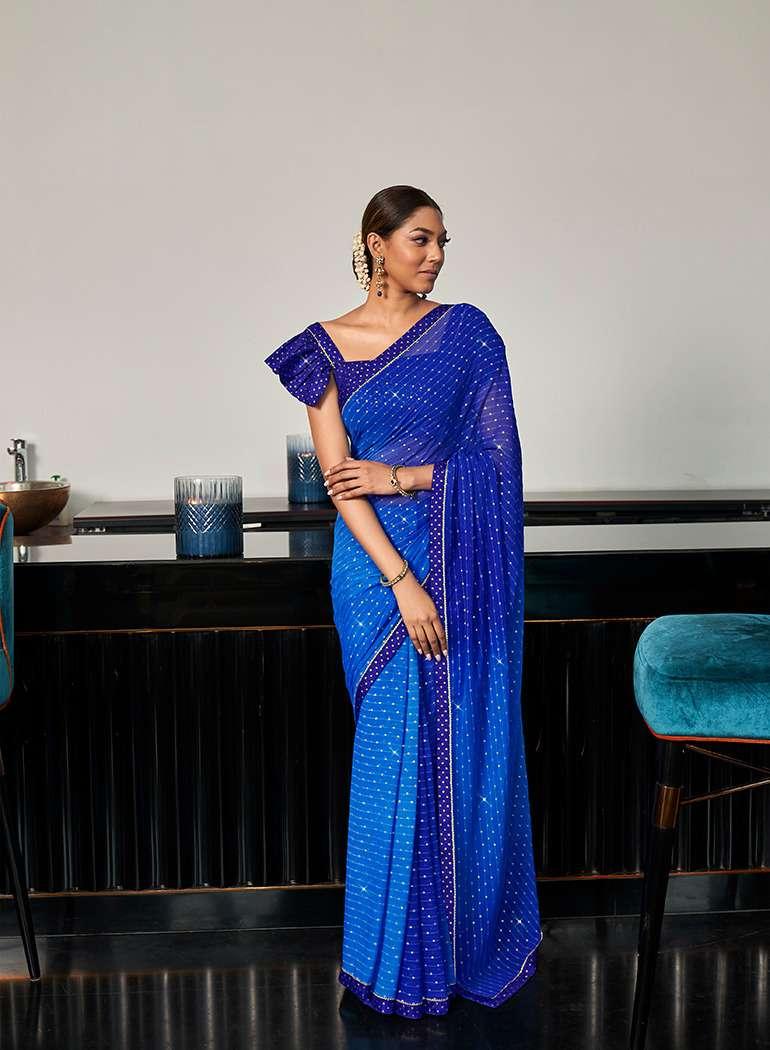 antra manasvi georgette printed designer fancy saree